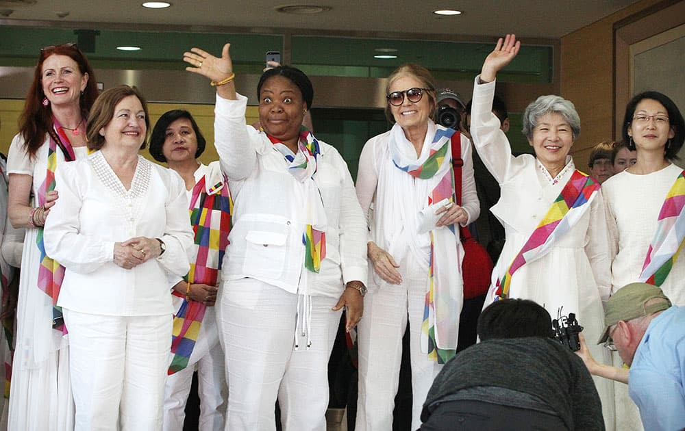 From second left, Nobel Peace Prize laureates Mairead Maguire and Leymah Gbowee, U.S. activist Gloria Steinem and other woman activists smile upon their arrival from North Korea at the office of the customs, immigration and quarantine in Paju, South Korea, near the border village of Panmunjom.