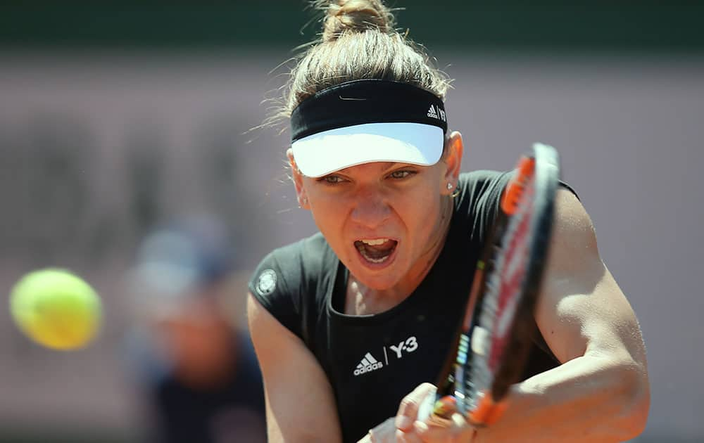Romania's Simona Halep returns in the first round match of the French Open tennis tournament against Evgeniya Rodina of Russia.