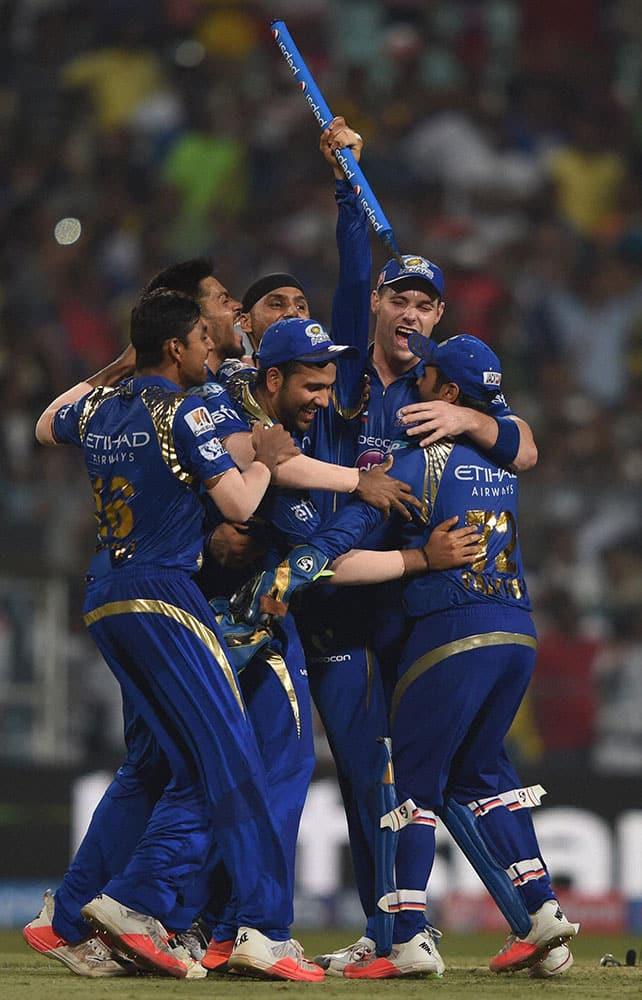 Mumbai Indian captain Rohit Sharma celebrate with team mates after beating Chennai Super Kings during the IPL 8 final at Eden Garden in Kolkata.