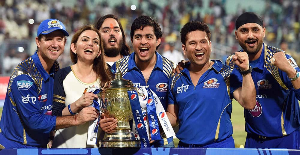 Mumbai Indians owner Nita Ambani along with team mentor Sachin Tendulkar, coach Ricky Ponting and player Harbhajan Singh celebrate with trophy after winning IPL8 final against Chennai Super Kings at Eden Garden in Kolkata.