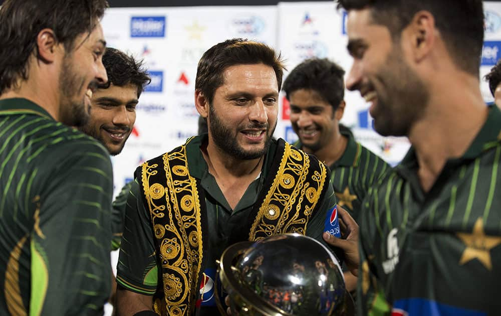 Shahid Afridi, center, captain of the Pakistani cricket team, celebrates the victory with players against Zimbabwe at the Gaddafi Stadium in Lahore, Pakistan.