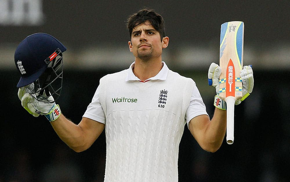 Englands Alastair Cook celebrates scoring 150 during the fourth day of the first Test match between England and New Zealand at Lords cricket ground in London.