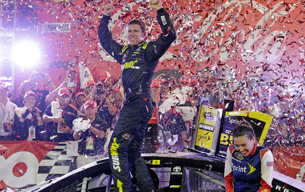 Carl Edwards celebrates in Victory Lane after winning the NASCAR Sprint Cup series auto race at Charlotte Motor Speedway in Concord, N.C.