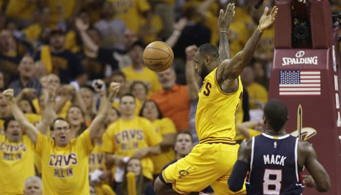 Hobbled LeBron James helps push Hawks to brink of elimination