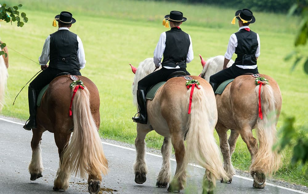 Participants of the Pentecost Ride ride on their horses near Bad Koetzting, Germany.