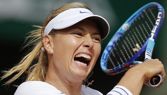 Maria Sharapova jeered off court, Andy Murray breezes through