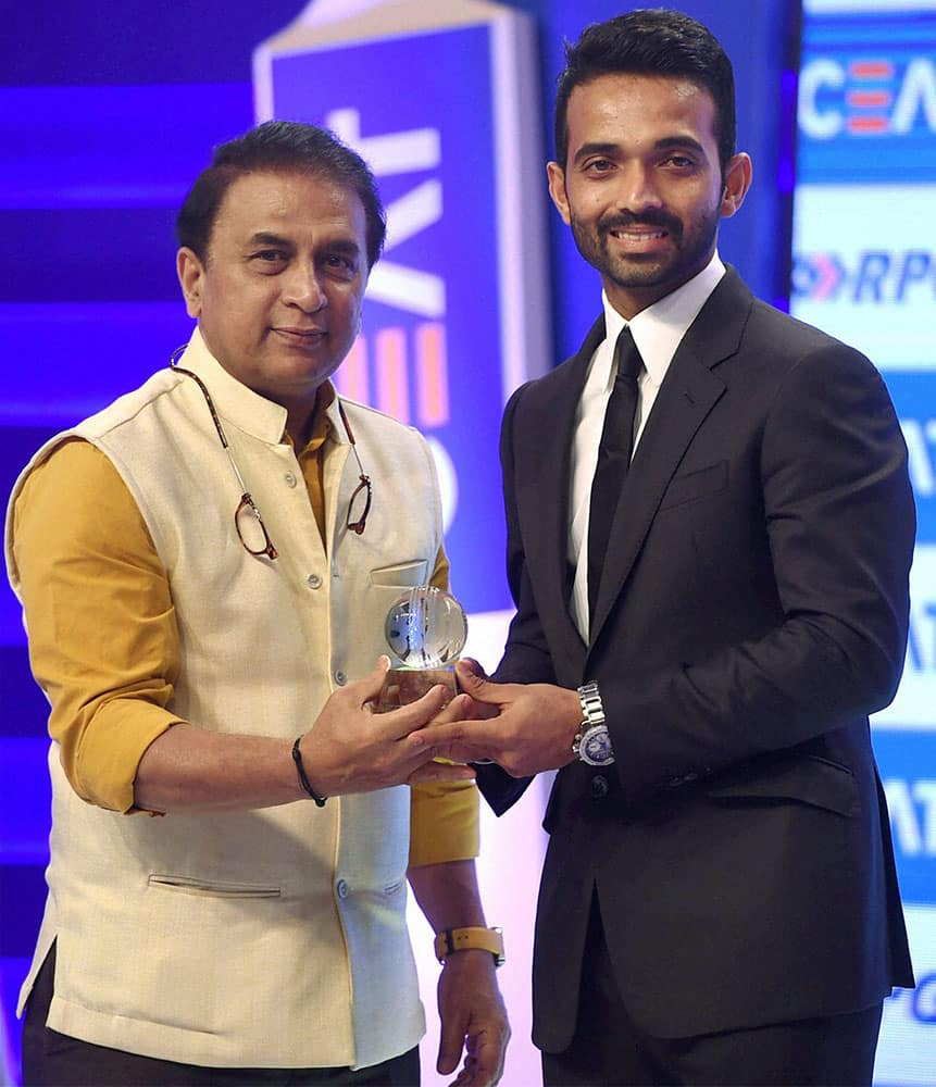 Cricketer Sunil Gawaskar felicitated Ajinkya Rahane with the Indian cricketer of year during the Ceat cricket rating awards in Mumbai.