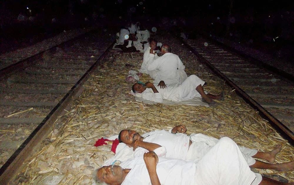 Gujjar community people sleep on train track as they agitating to demand reservation in government jobs and educational institutions for their community on Delhi-Mumbai railway track near Bayana village in Bharatpur district of Rajasthan.