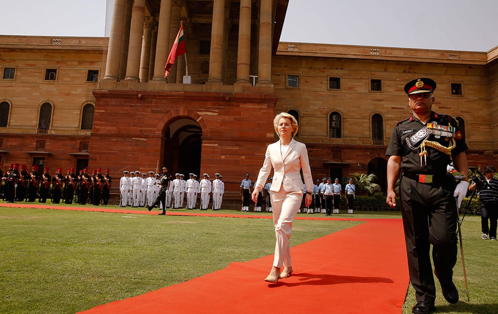 German Minister of Defense Ursula von der Leyen returns after inspecting a join defense guard of honor at the Indian Defense Ministry in New Delhi.