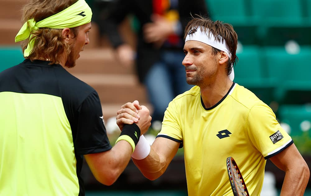 Spain's David Ferrer, right, shakes hands with Slovakia's Lukas Lacko after their first round match of the French Open tennis tournament at the Roland Garros stadium in Paris. Ferrer won 6-1, 6-3, 6-1.