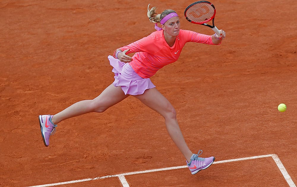 Petra Kvitova of the Czech Republic returns in the first round match of the French Open tennis tournament against Marina Erakovic of New Zealand at the Roland Garros stadium, in Paris, France.