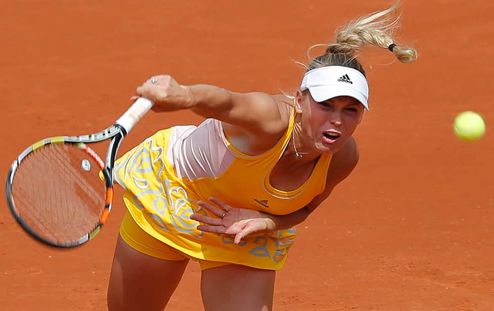 Denmark's Caroline Wozniacki serves in the first round match of the French Open tennis tournament against Italy's Karin Knapp at the Roland Garros stadium, in Paris, France.