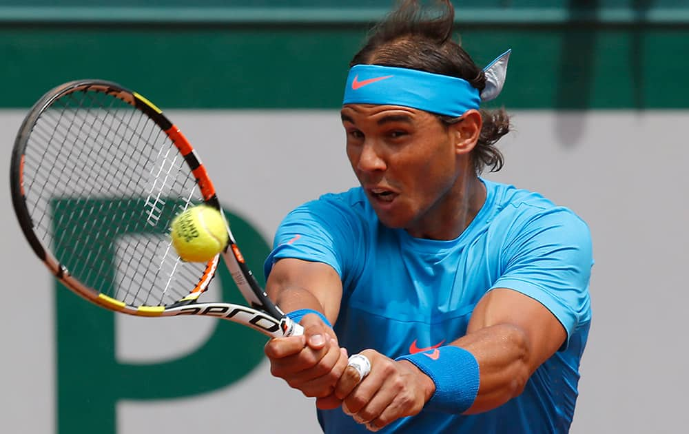 Spain's Rafael Nadal returns in the first round match of the French Open tennis tournament against Quentin Halys of France at the Roland Garros stadium, in Paris, France.