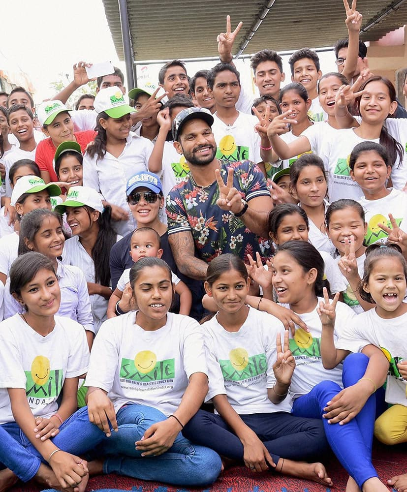 Shikhar Dhawan with Smile Foundation kids at an event.