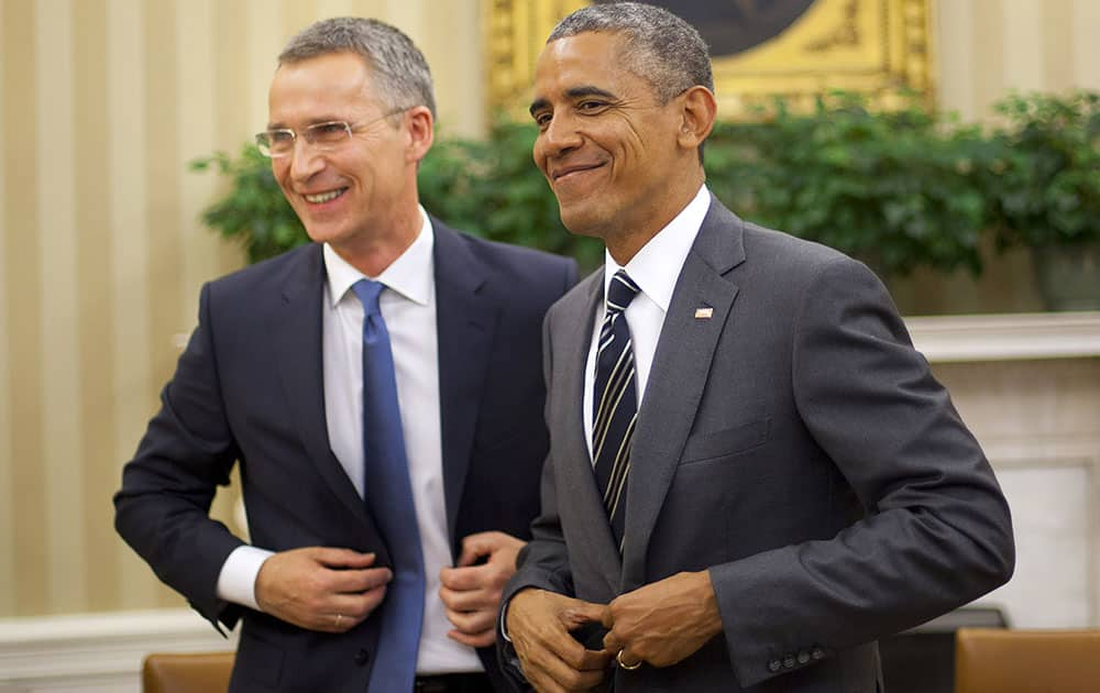 President Barack Obama and NATO Secretary General Jens Stoltenberg, get up from their seats following their meeting, in the Oval Office of the White House in Washington.