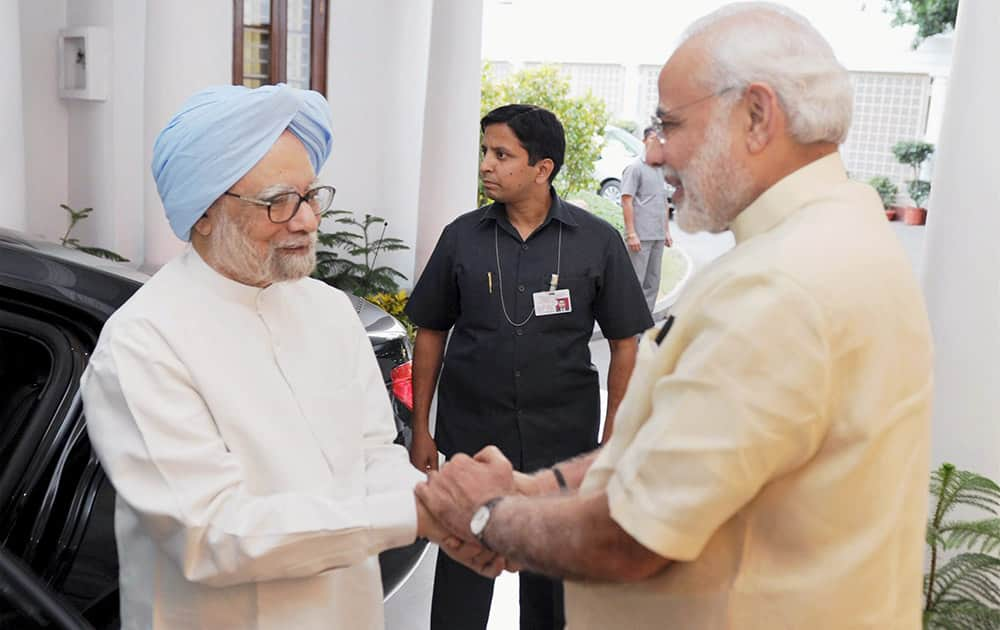 Prime Minister Narendra Modi and former Prime Minister Manmohan Singh at 7RCR in New Delhi. Very happy to meet Dr Manmohan Singh Ji, PM Modi tweeted.