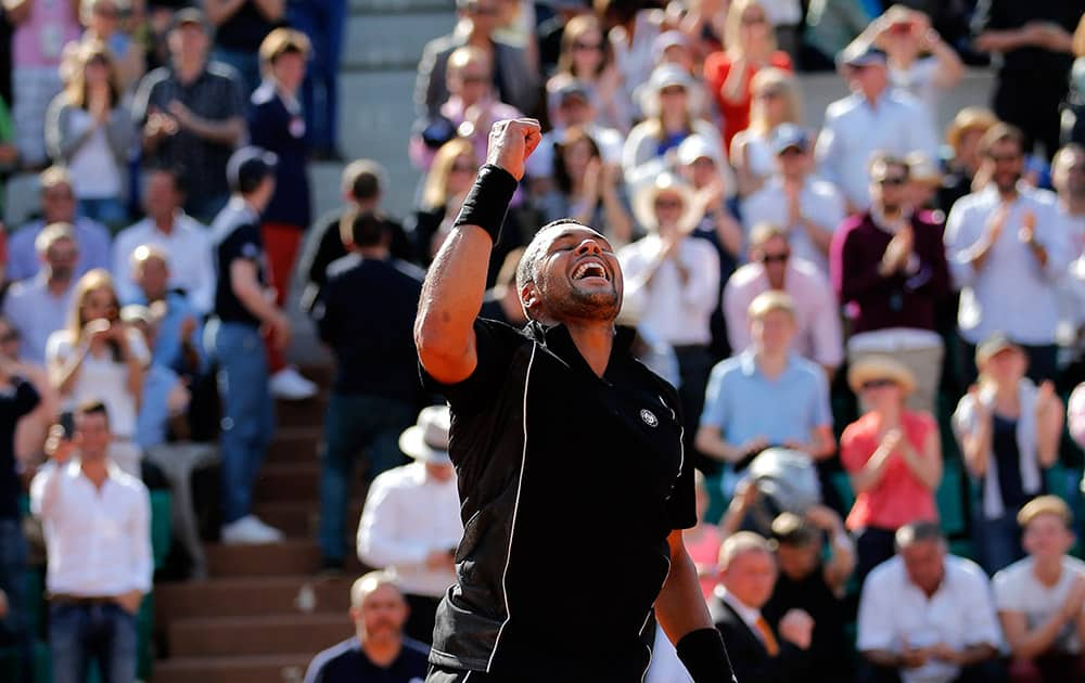 France's Jo-Wilfried Tsonga celebrates after defeating Israel's Dudi Sela in their second round match of the French Open tennis tournament at the Roland Garros stadium in Paris.