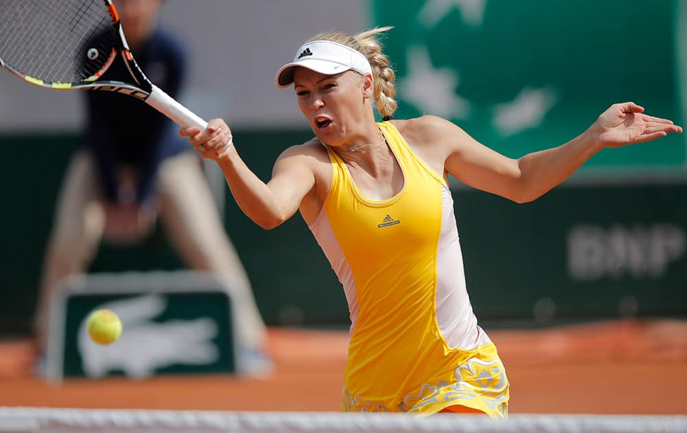Denmark's Caroline Wozniacki returns in the second round match of the French Open tennis tournament against Germany's Julia Georges at the Roland Garros stadium, in Paris, France.