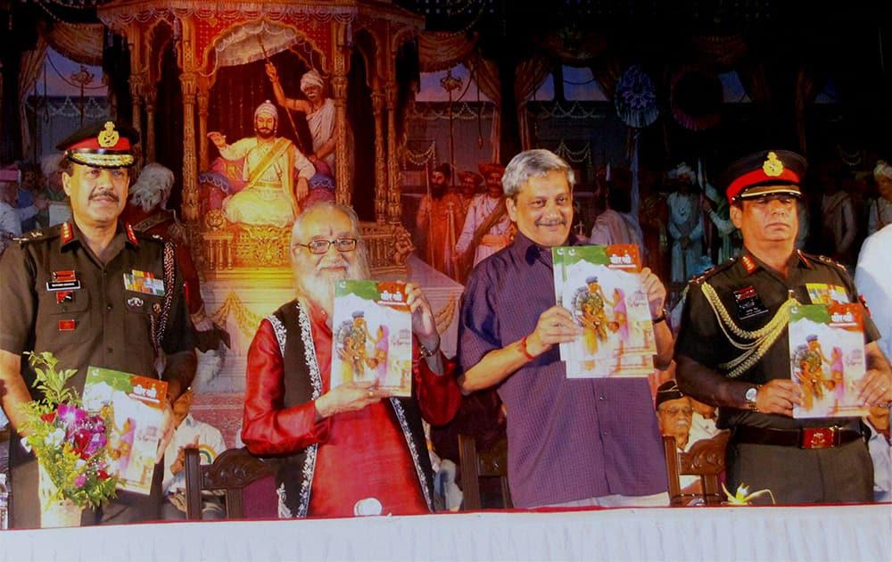 Defence Minister Manohar Parrikar releases a booklet during a Sainik Samman Samaroh in Pune.