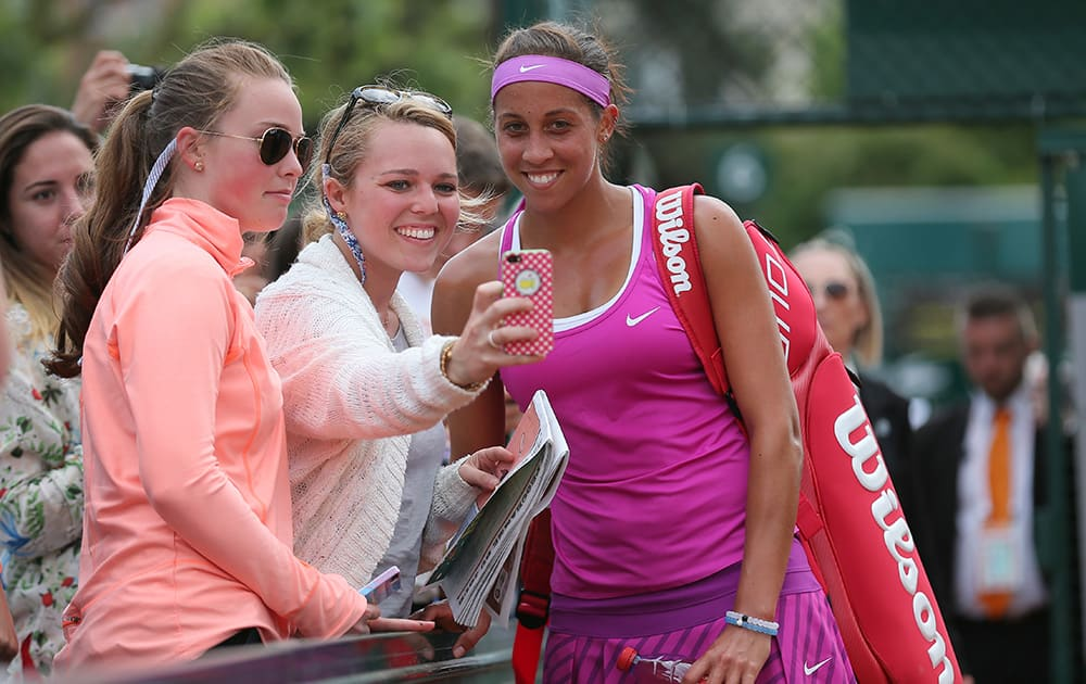 Madison Keys of the US poses for selfie with tennis lovers after defeating Belinda Bencic of Switzerland in their second round match of the French Open tennis tournament at the Roland Garros stadium.