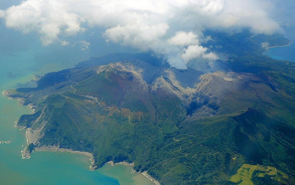 A column of smoke raises from Mount Shindake on Kuchinoerabu island, southern Japan.
