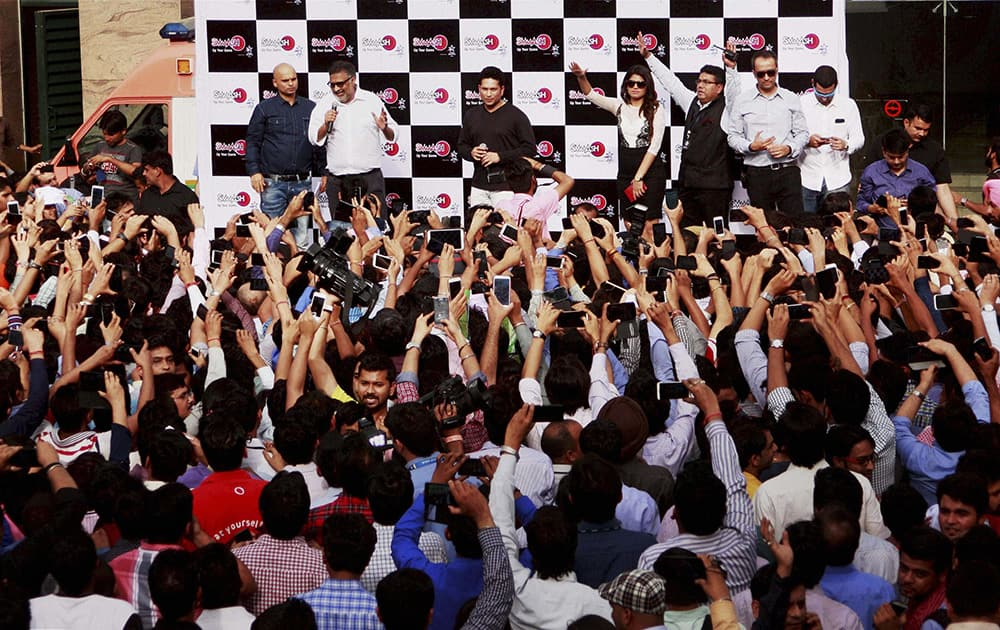 Cricket legend Sachin Tendulkar talking to media person during an event in Gurgaon.