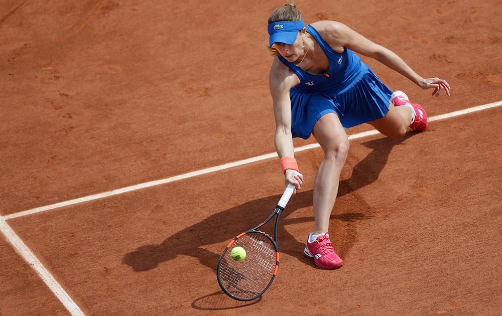 France's Alize Cornet returns in the third round match of the French Open tennis tournament against Croatia's Mirjana Lucic-Baroni at the Roland Garros stadium, in Paris, France.