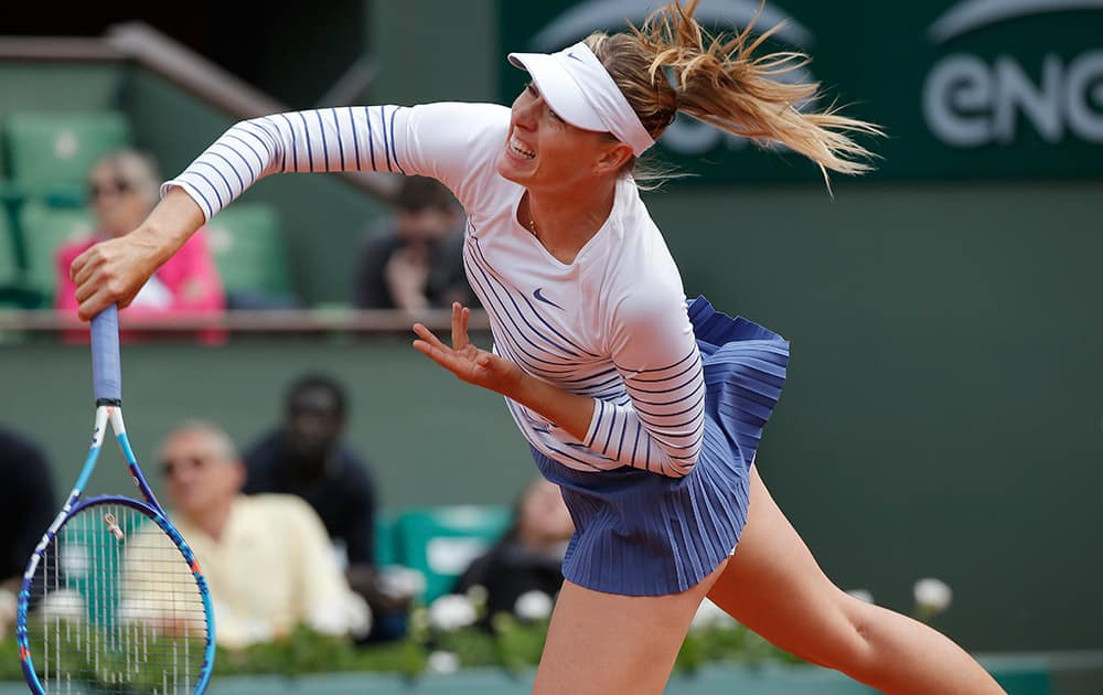 Russia's Maria Sharapova returns in the third round match of the French Open tennis tournament against Australia's Samantha Stosur at the Roland Garros stadium, in Paris, France.