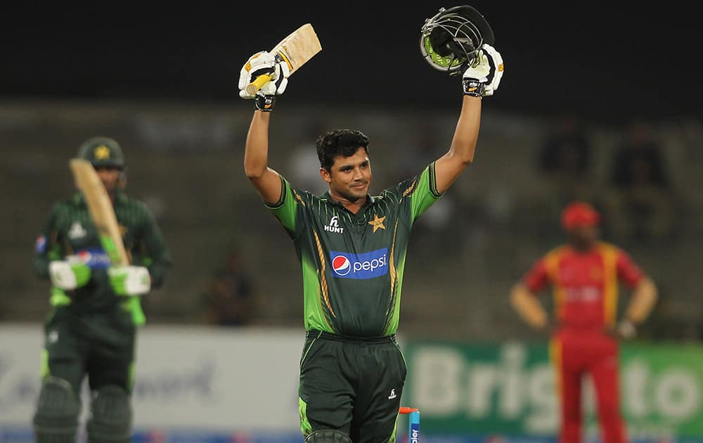 Pakistan's captain Azhar Ali acknowledges his century against Zimbabwe during the second one-day international at Gaddafi Stadium in Lahore, Pakistan.