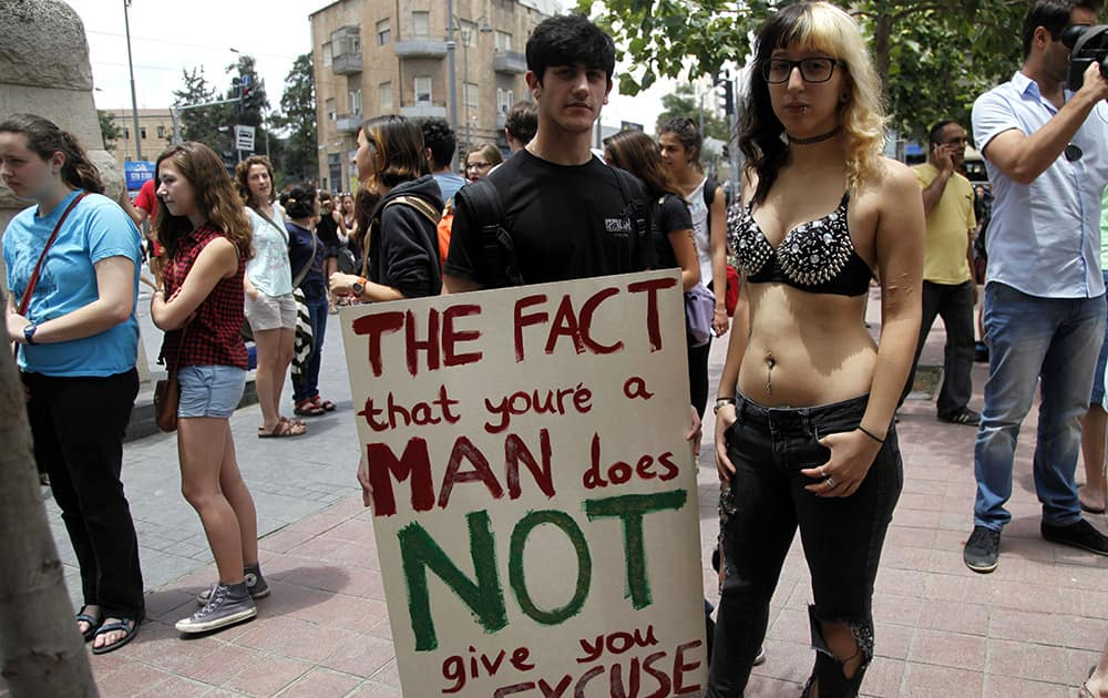 Israelis demonstrators hold up a sign against sexual assault, as they march in an annual