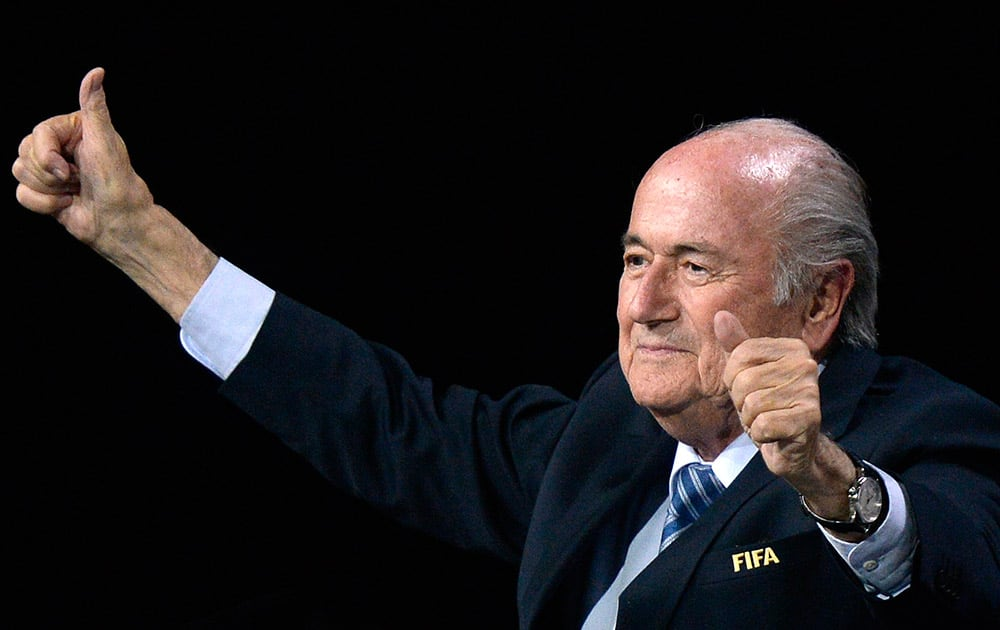 FIFA president Sepp Blatter gestures after his re-election during the 65th FIFA Congress held at the Hallenstadion in Zurich, Switzerland.