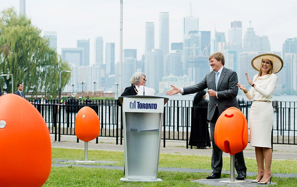 King Willem-Alexander and Queen Maxima of the Netherlands try out the new Tulpi chairs at a presentation on the Toronto Islands in Toronto.