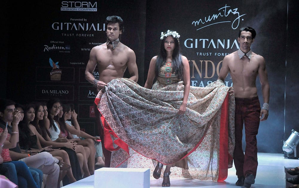 Models walk the ramp at Indore Fashion Week in Indore.