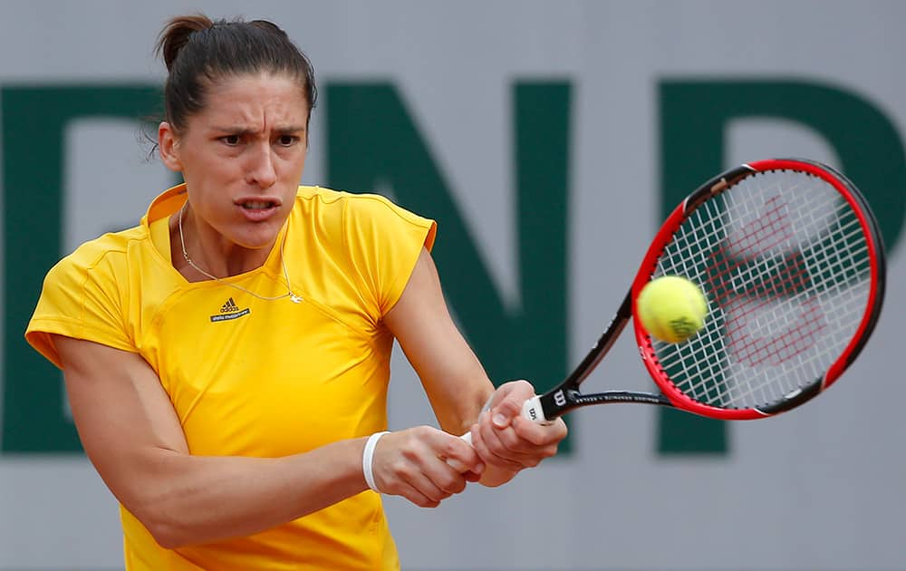 Germany's Andrea Petkovic returns in the third round match of the French Open tennis tournament against Italy's Sara Errani at the Roland Garros stadium, in Paris, France.