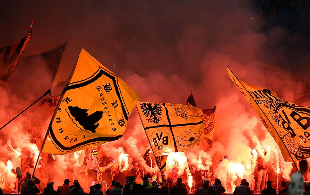 Dortmund supporters light flares during the German soccer cup final match between Borussia Dortmund and VfL Wolfsburg in Berlin, Germany.