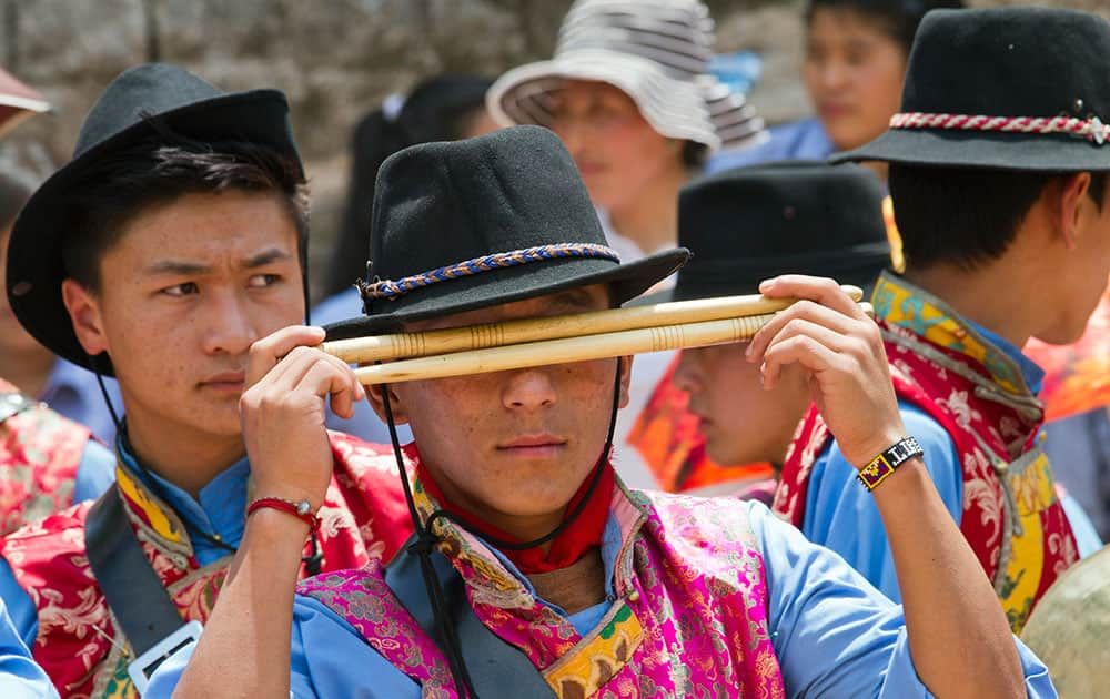 Exile Tibetan students in traditional attire prepare to play in the school band during the opening ceremony of the Gyalyum Chemo Memorial Gold Cup soccer tournament at the Tibetan Children's Village School in Dharmsala, India.