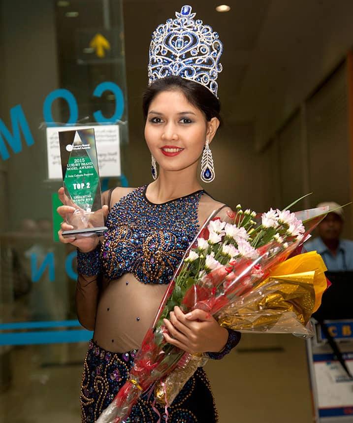 Myanmar model Zun Than Zin poses for photos upon her arrival at Yangon International airport in Yangon, Myanmar, after winning the Luxury Brand Model Awards held in South Korea.