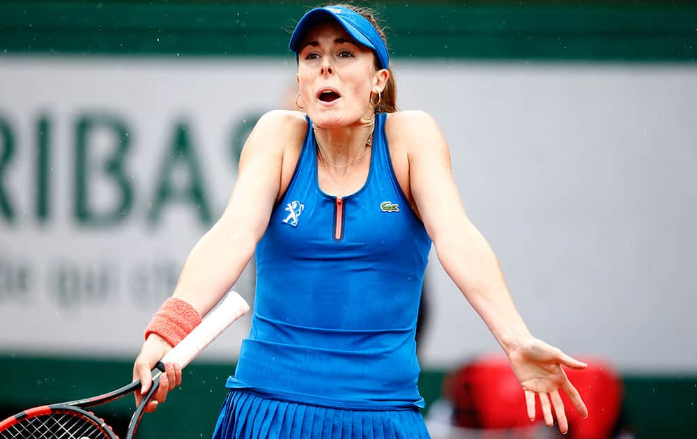 France's Alize Cornet reacts as she plays Ukraine's Elina Svitolina during their fourth round match of the French Open tennis tournament at the Roland Garros stadium.