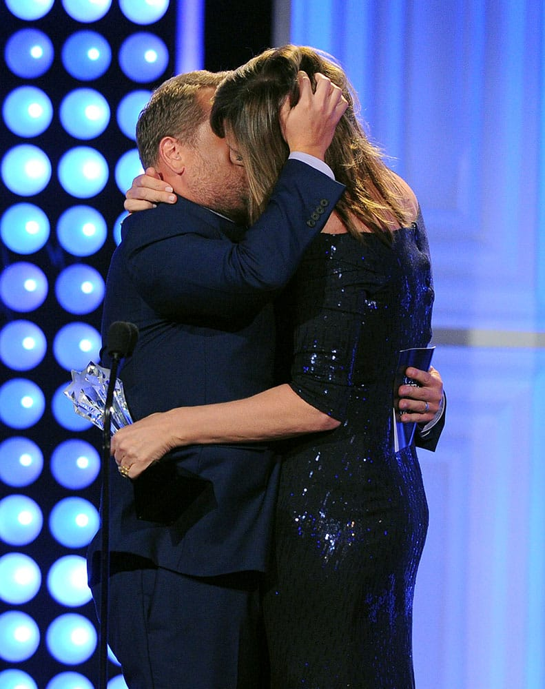 """James Corden, left, kisses Allison Janney as he presents her the award for best supporting actress in a comedy series for """"Mom"""" at the Critics' Choice Television Awards at the Beverly Hilton hotel, in Beverly Hills, Calif."""