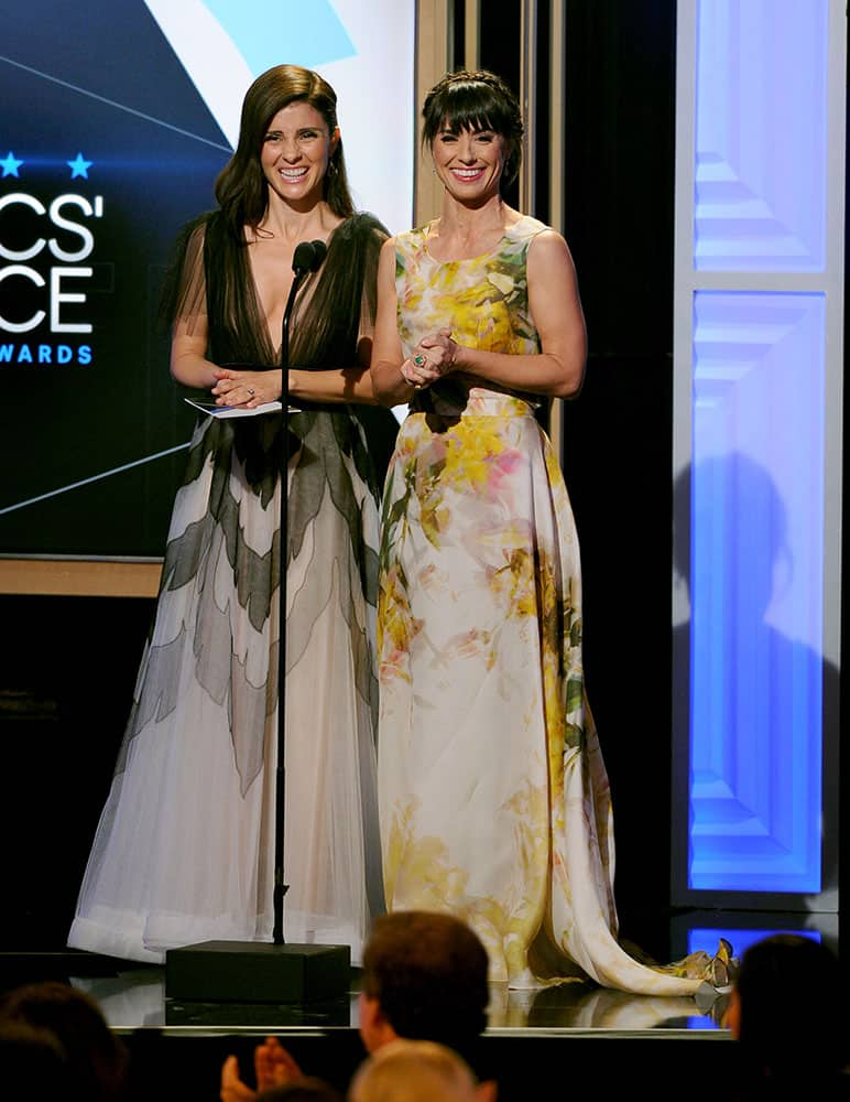 Shiri Appleby, left, and Constance Zimmer present the award for best reality series at the Critics' Choice Television Awards at the Beverly Hilton hotel.