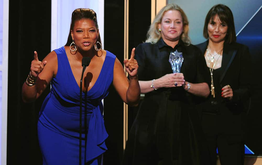 "Queen Latifah, left, and Lili Fini Zanuck accept the award for best movie made for television for ""Bessie"" at the Critics' Choice Television Awards."