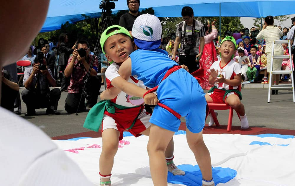 North Korean boys play the Korean wrestling during an International Children's Day event at an orphanage in Pyongyang, North Korea.