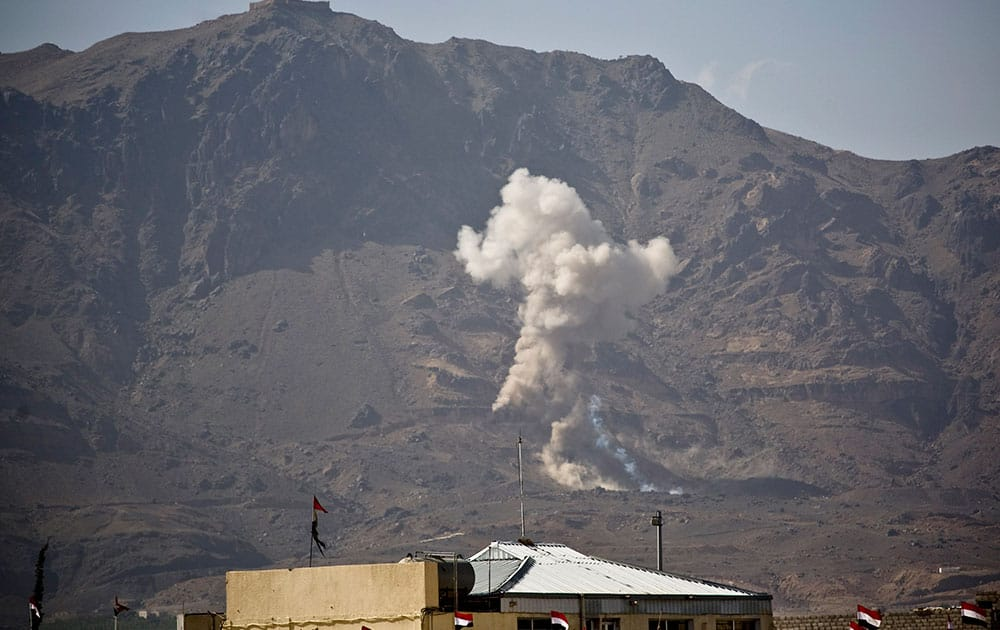 Smoke rises after a Saudi-led airstrike hit a site believed to be one of the largest weapons depot on the outskirts of Yemen's capital, Sanaa.