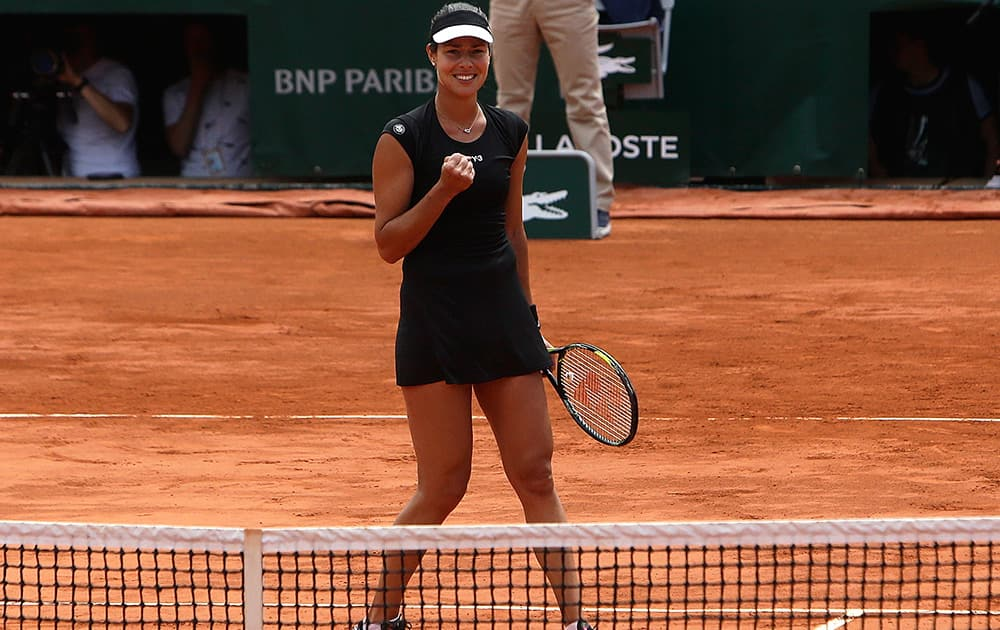 Serbia's Ana Ivanovic reacts as she defeats Ukraine's Elina Svitolina during their quarterfinal match of the French Open tennis tournament at the Roland Garros stadium in Paris. Ivanovic won 6-3, 6-2.