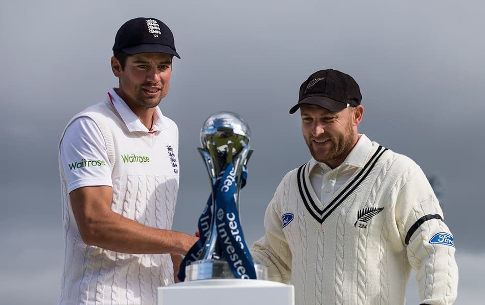 New Zealand's Brendon McCullum, right, shakes hands with England's captain Alastair Cook after the tourist's match win and therefore drawn series on the fifth day of the second Test match between England and New Zealand at Headingley cricket ground in Leeds, England.