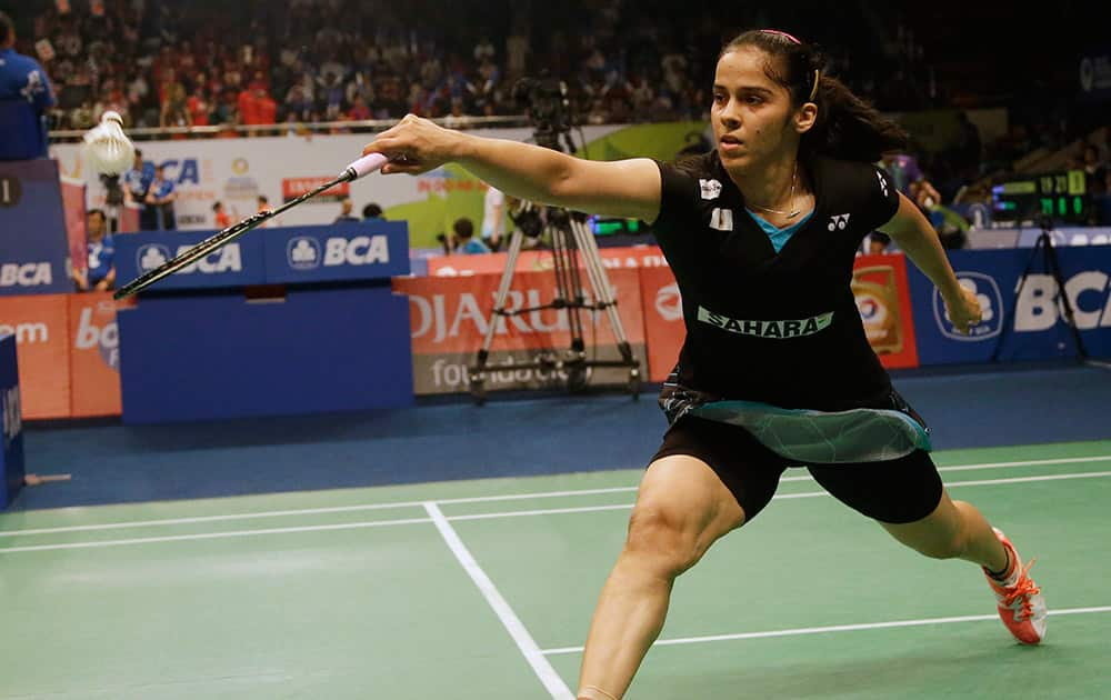 Saina Nehwal makes a backhand return during her qualifying match at the Indonesia Open badminton tournament at Istora Stadium in Jakarta, Indonesia.