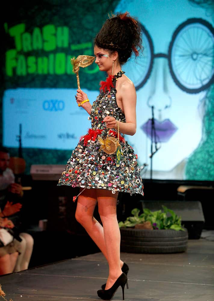 A model presents a creation made of hundreds of buttons during Trash Fashion Show in Macedonia's capital Skopje.
