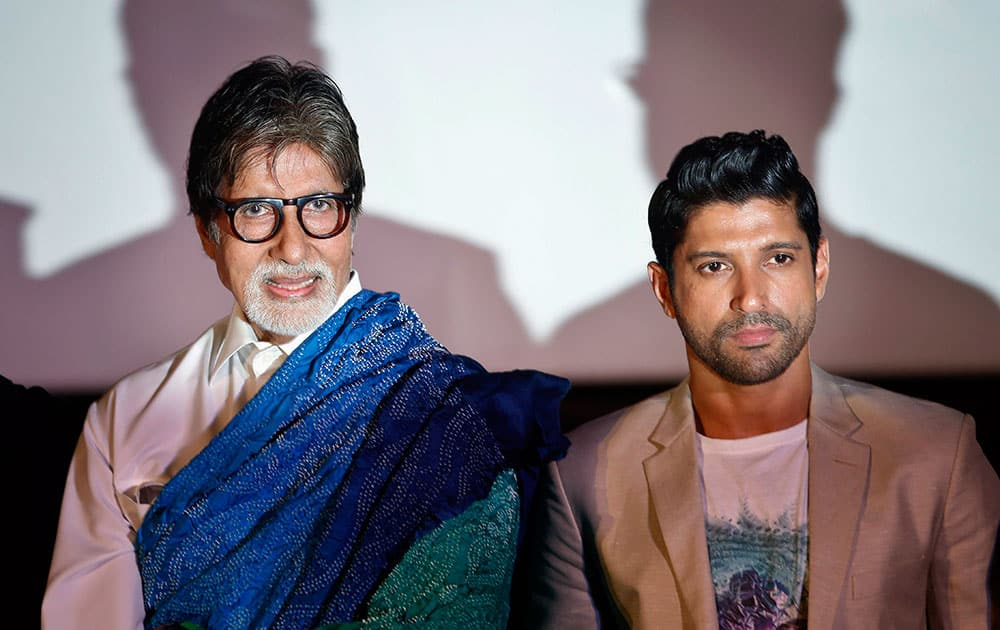 """Bollywood actors Amitabh Bachchan, left, and Farhan Akhtar pose for the media during a trailer launch of their movie """"Wazir"""" in Mumbai."""