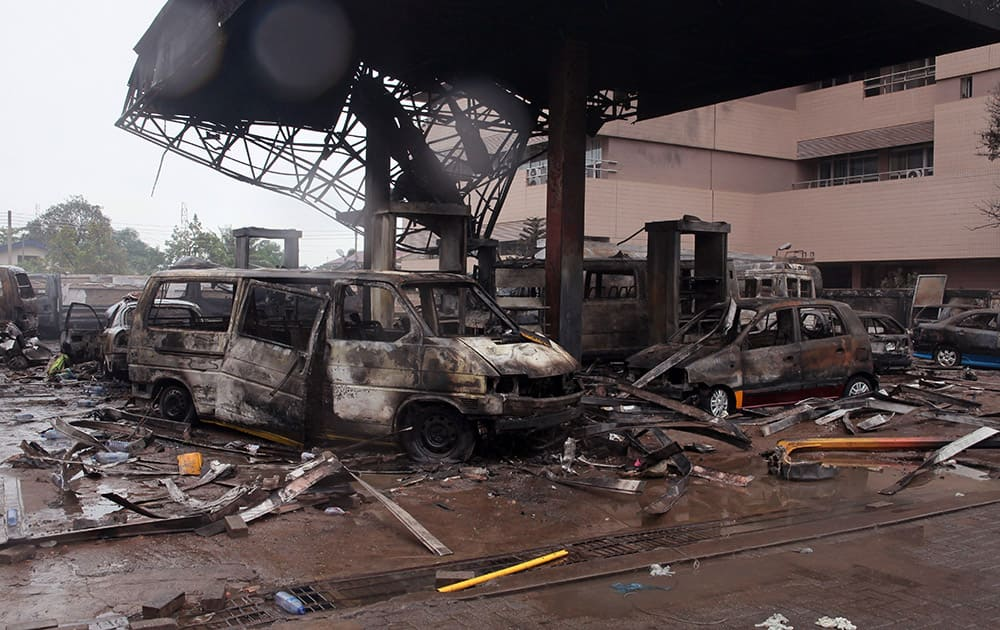 The remaining structure of a gas station after it exploded in Accra, Ghana. Flooding in Ghana's capital swept stored fuel into a nearby fire, setting off a huge explosion at a gas station that killed dozens of people and set alight neighboring buildings, authorities said Thursday.