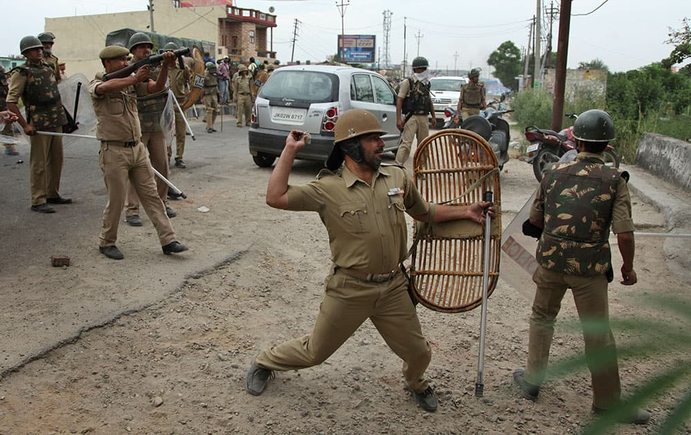 Police throw stones at Sikh protesters as they clash during a protest in Jammu, India. he protests triggered by the removal of posters of Sikh leader Jarnail Singh Bhindranwale by police yesterday left one protester killed and over a dozen others injured Thursday, according to local reports.